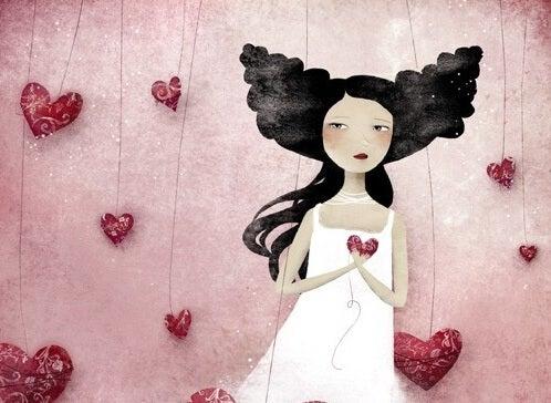 mujer corazones reparando la herida