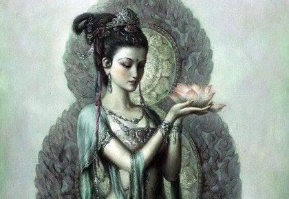 Mujer hindú con un nenúfar