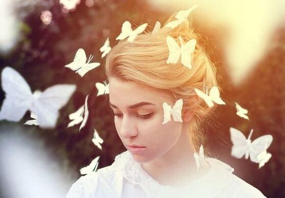butterflies surrounding girl