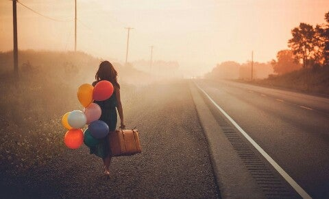 woman carrying balloons