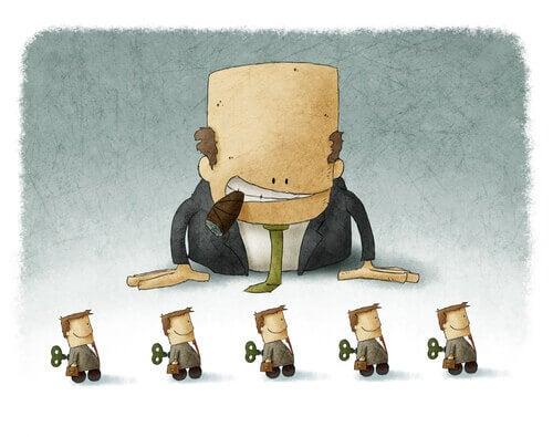 Hombre fanático del control manipulando a sus empleados imagen simbolizando el el chiste según Freud