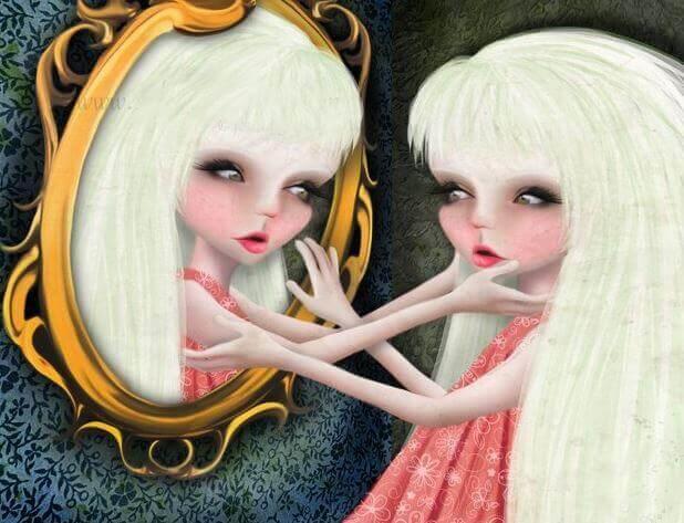 Mujer narcisista mirándose a un espejo