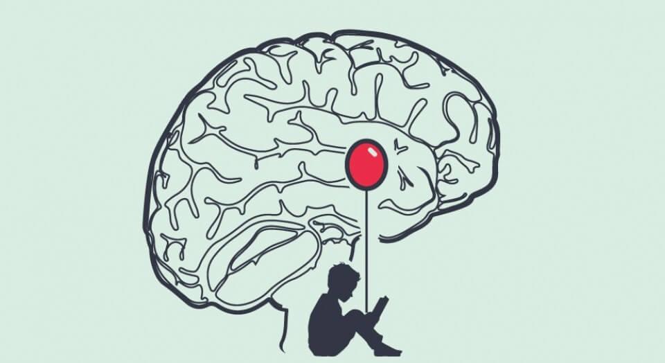 cerebro con un niño con globo representando la amígdala