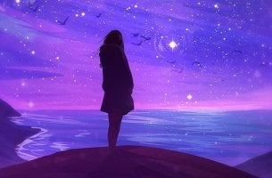 chica mirando estrellas frente al mar preguntándose cuando conseguiré mis objetivos