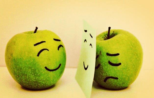 manzana alegre frente a manzana triste representando el Efecto Hawthorne