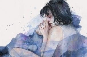 mujer con pelo oscuro acurrucada por la ansiedad flotante