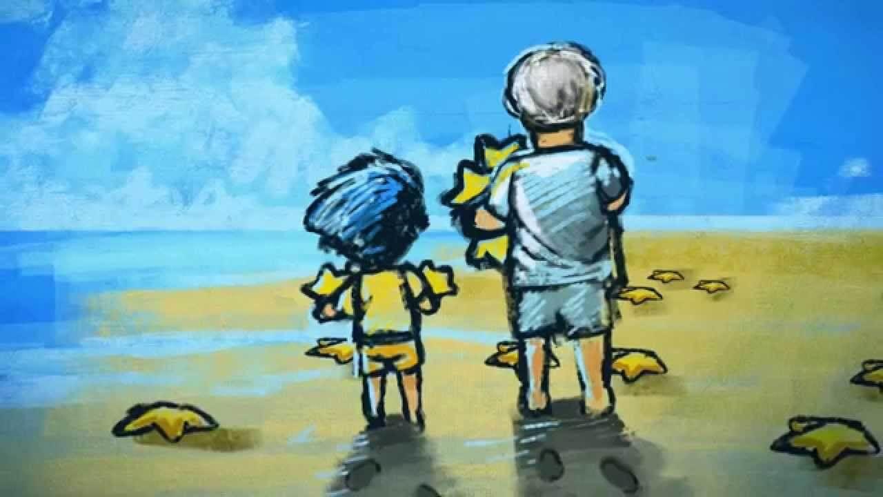 niño con su padre recogiendo estrellas de mar y contándole una leyenda