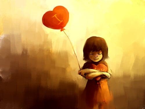 Niña con un globo de corazón pensando en amor no correspondido