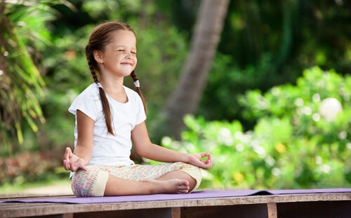 girl doing meditation in garden