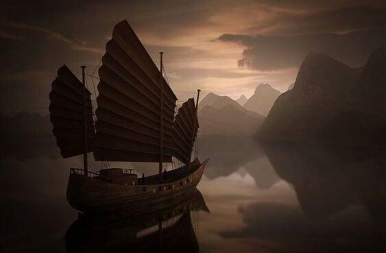barco con velas oscuras