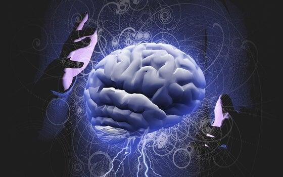 cerebro rodeado de manos representando el control mental