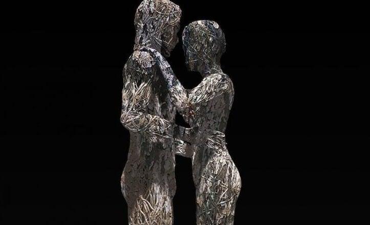figura de una pareja mirándose de frente