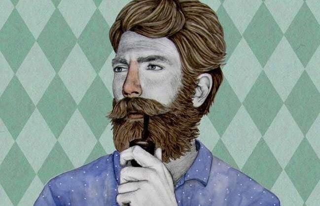 hombre con barba fumando en pipa