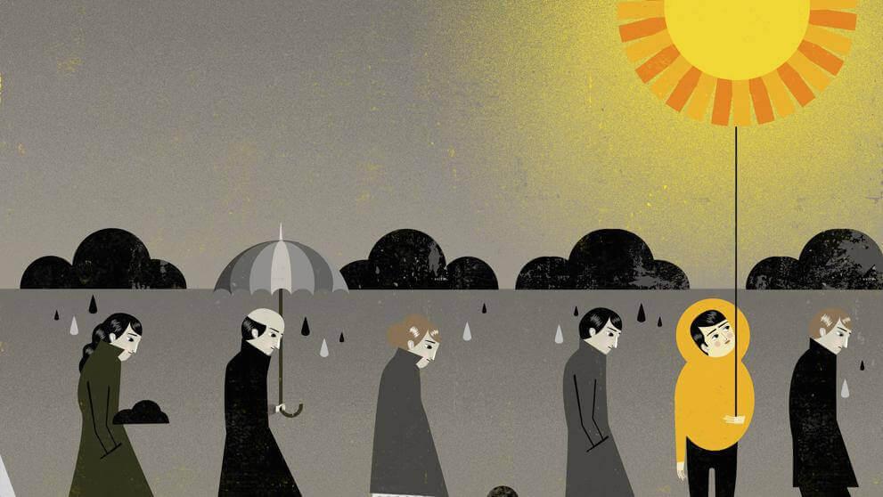 Hombre con sol rodeado de personas grises