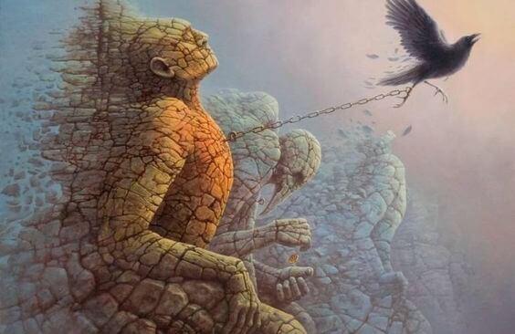 hombre de piedra anclado a cadena tirada de un pájaro
