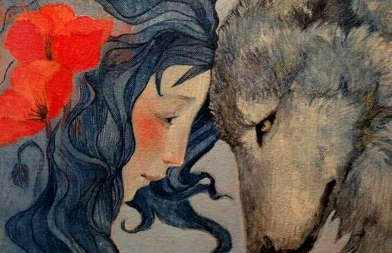 mujer apoyando su cabeza frente a un lobo