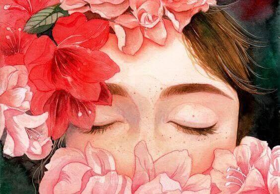 Mujer con los ojos cerrados rodada de flores