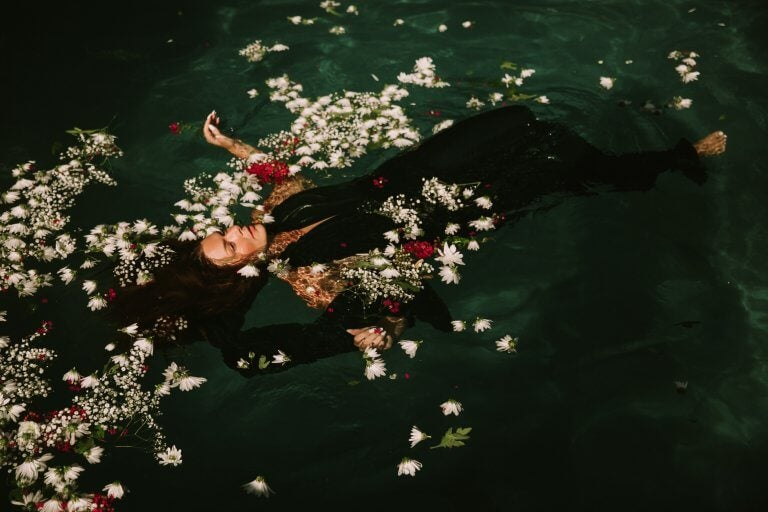 woman floating with flowers: emotional intelligence.