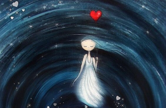 niña con un globo en forma de corazón