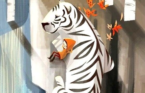 niño tumbado con un tigre blanco representando la fuerza de la actitud