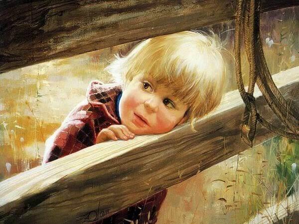 Niño apoyando su cabeza sobre una madera