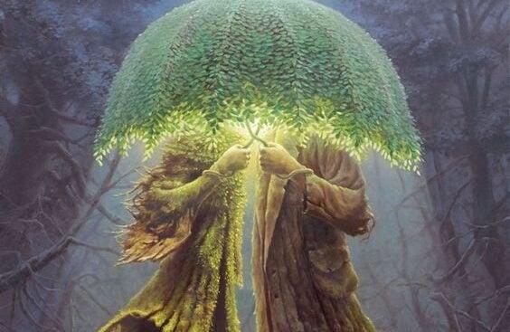 pareja escondida bajo un paraguas de hojas