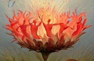 personas bailando dentro de una flor