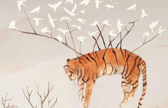 tigre en el aire llevado por pájaros