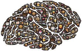 Cerebro con alimentos representando el vínculo entre emoción y alimentación