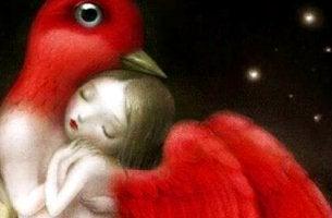 chica con alas que siente el amor abrazada a un pájaro