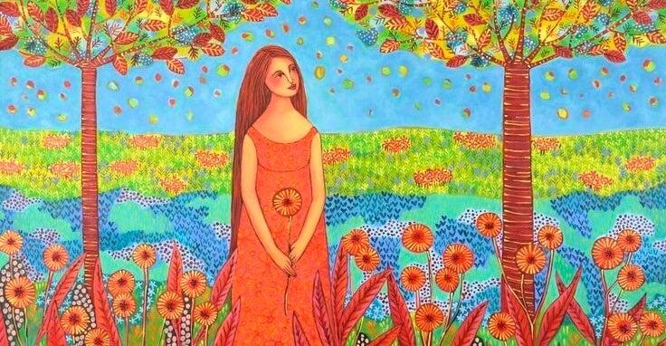 chica en campo de flores