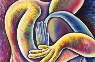 Figuras abrazándose simbolizando la compasión