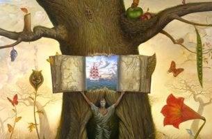 hombre abriendo libro sobre Inteligencia Emocional en un árbol