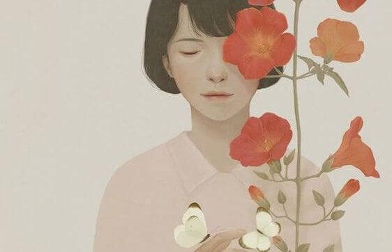 mujer en soledad al lado de flores rojas