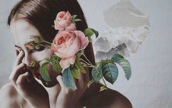 mujer con flor en el rostro
