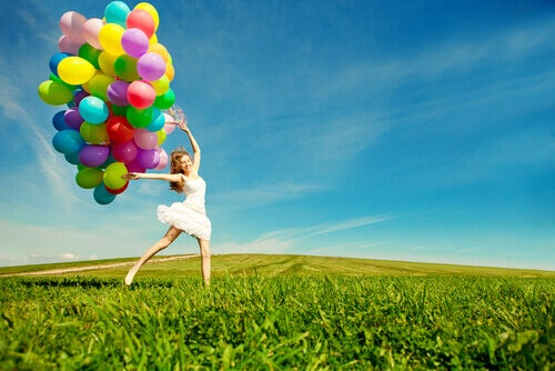 playful woman with balloons