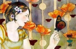 mujer con mariposa en la mano que aguarda lo inesperado