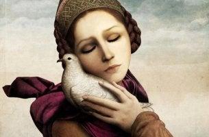 mujer con paloma en el hombro que piensa en su felicidad perdida