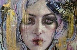 mujer triste con depresión y mariposa a un lado