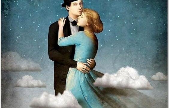 pareja abrazada y rodeada de nubes