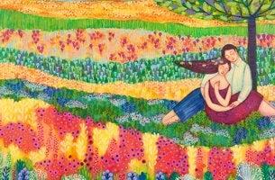 Pareja en campo de flores disfrutando de lo bonito de la vida