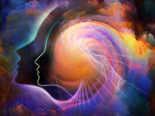Silueta de la cabeza de una persona con ráfagas de colores