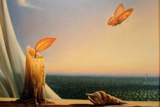 vela de la que se desprende una mariposa