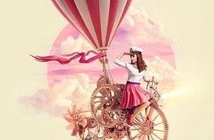 chica en una bicicleta volando hacia el éxito