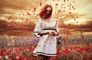 chica rodeada de flores para expresar sus emociones