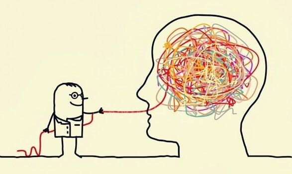 hombre que saca hilos de una cabeza representando el arte de estudiar psicología