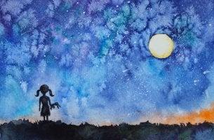 Niña mirando una estrella