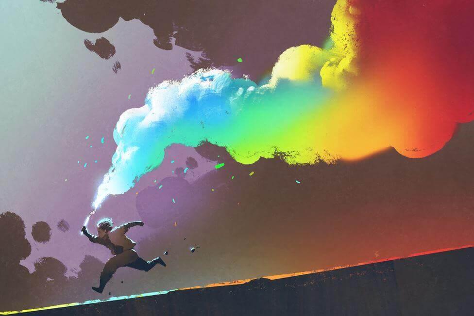 Niño con humo de colores