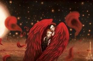 Pareja en el interior de unas alas rojas sintiendo la química del amor