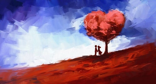 Pareja a la sombra de un árbol con forma de corazón para representar el amor completo